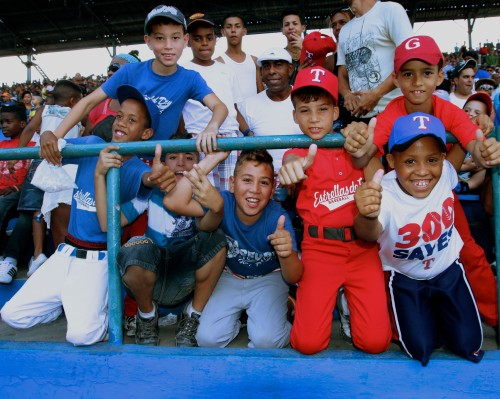 Young fans at baseball game.