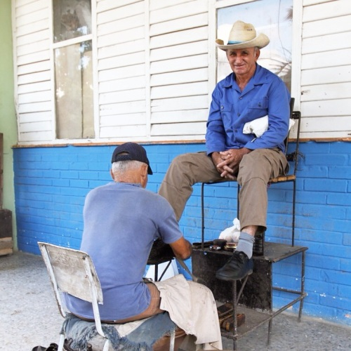 Getting a shoe shine in Pinar del Rio.