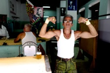 Showing some muscle in an Old Havana bar.